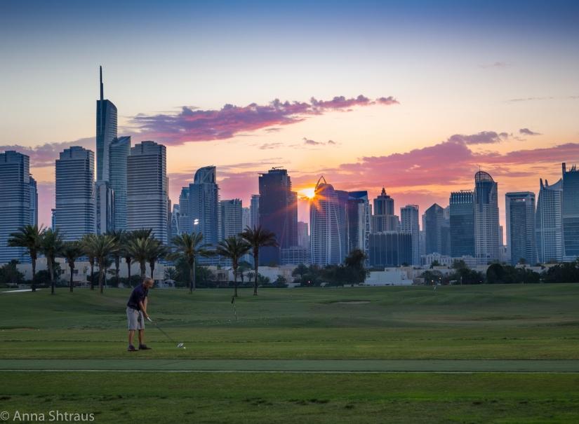 A golf player atsunset